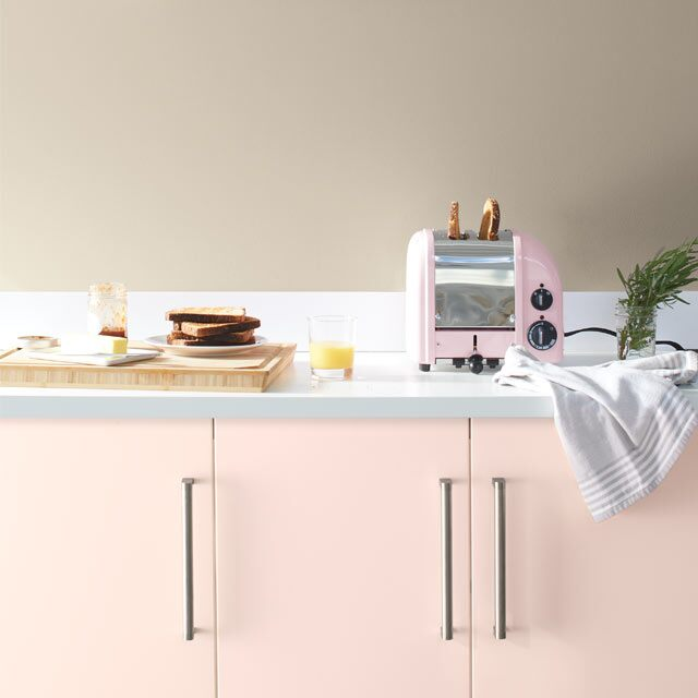 A pale kitchen with pink cabinets painted with Benjamin Moore